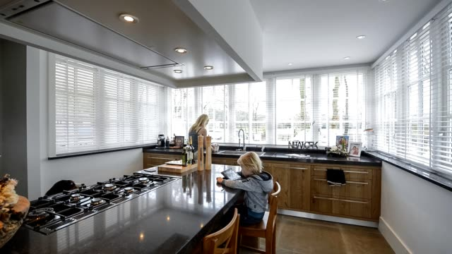domestic scene in beautiful kitchen in luxury home with cooking island - open house stock videos & royalty-free footage