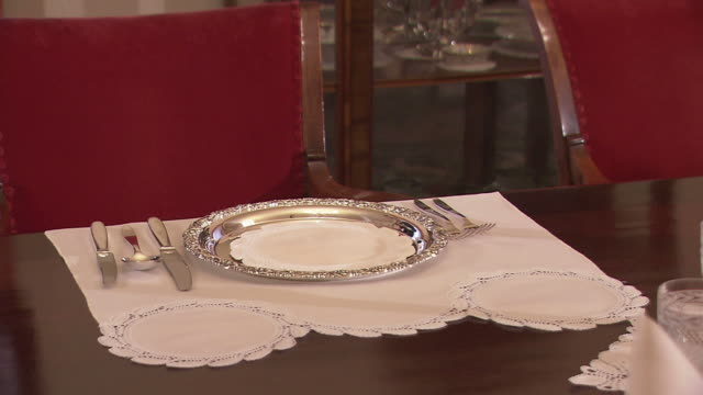 MS Domestic servant placing silverware on table for elegant place setting/ Slovenia