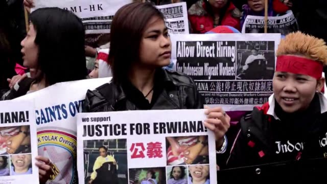 domestic workers take to the streets of hong kong to demand justice for an indonesian maid allegedly tortured by her employers and better protection... - fordern stock-videos und b-roll-filmmaterial
