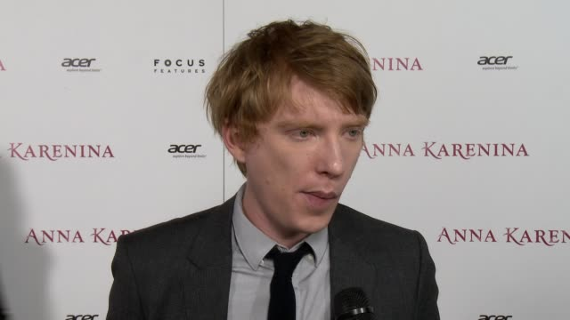 domhnall gleeson on reading the book anna karenina as he was preparing for his audition, on the way the film was shot in a threatre, working with joe... - ジョーライト点の映像素材/bロール
