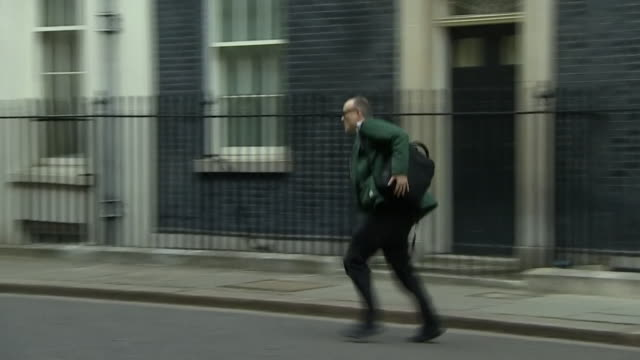dominic cummings adviser to pm boris johnson running out of 10 downing street after learning his wife had fallen ill with coronavirus symptoms - international landmark stock videos & royalty-free footage