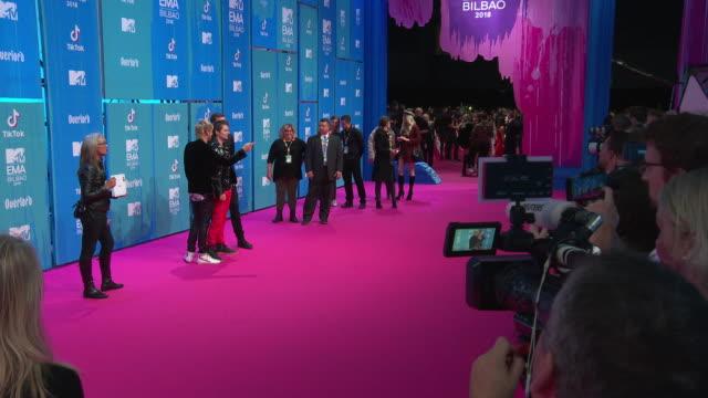 dominic howard, matt bellamy, chris wolstenholme, muse at mtv europe music awards on november 04, 2018 in bilbao, spain. - mtv europe music awards stock videos & royalty-free footage