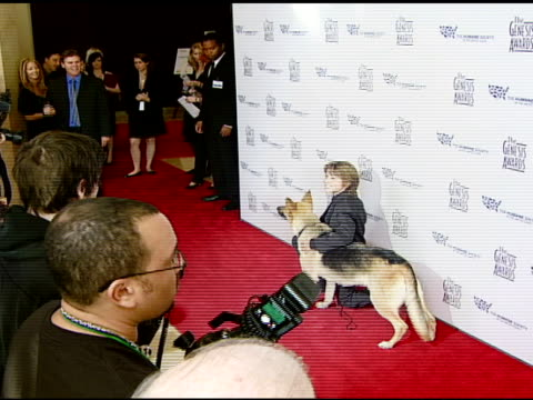 Dominic Scott Kay with Abbey the German Shepherd at the 2008 Genesis Awards at the Beverly Hilton in Beverly Hills California on March 30 2008