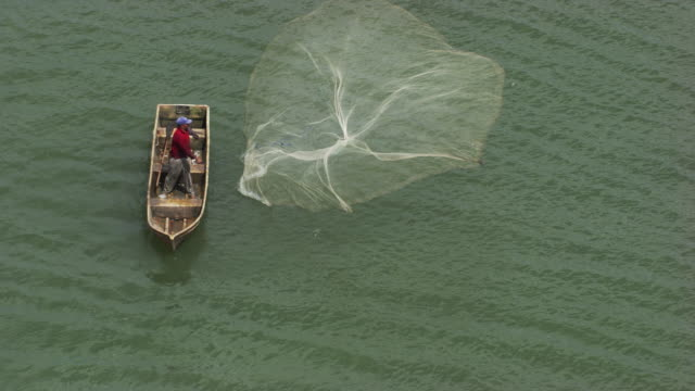 Dominican Republic: Fishers with fishing nets
