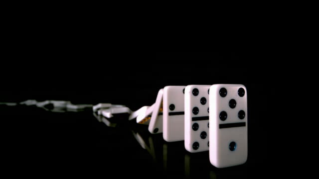 domino effect - dominoes stock videos & royalty-free footage
