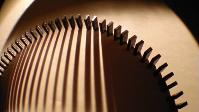 tinted overhead dominoes falling in curved line with shadows - still life stock videos and b-roll footage