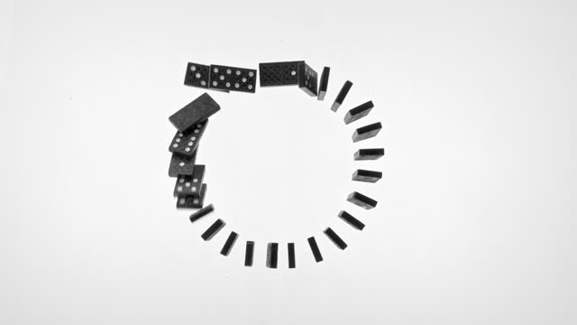 slo mo ld dominoes set in a circle falling down on white surface - less than 10 seconds stock videos & royalty-free footage