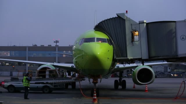 domodedovo airport 10 an s7 airlines passenger jet stands outside the terminal at domodedovo airport zao in domodedovo russia on friday april 21... - 給油点の映像素材/bロール