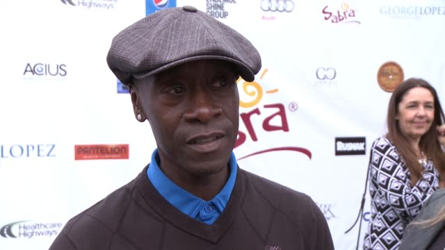 INTERVIEW Don Cheadle on being a part of today what he appreciates about George and his philanthropic efforts if he's an avid golfer what he enjoys...