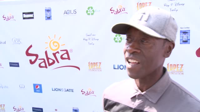 INTERVIEW Don Cheadle on if it gets competitive at The 7th Annual George Lopez Celebrity Golf Classic Presented By Sabra Salsa at Lakeside Golf Club...