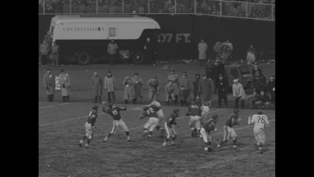 don heinrich, ny giants quarterback, drops back and throws short pass in game against chicago bears / heinrich pump fakes and throws deep for a 65... - nfc east stock videos & royalty-free footage