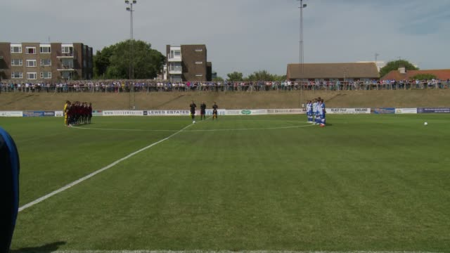 minute silence ahead of brighton football match england west sussex lewes ext brighton and hove albion football team and opposition team and... - 英国 ブライトン点の映像素材/bロール