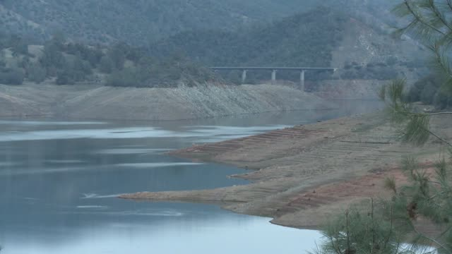 don pedro reservoir water level plunges amid long dry spell in california / water supplies dwindle - reservoir stock videos & royalty-free footage