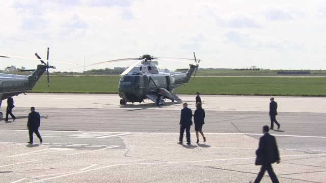 donald and melania trump getting into a waiting helicopter at stansted airport on the president's state visit to the uk - air force one stock videos & royalty-free footage