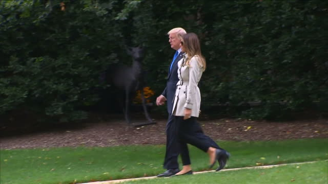 Donald and Melania Trump walking