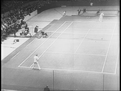 Donald Budge plays and wins against Bill Tilden in a men's single tennis match