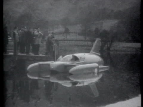 donald campbell's bluebird raised from seabed lib b/w 'bluebird' on lake before speed record bid campbell seen in cockpit of boat b/w 'bluebird'... - record breaking stock videos & royalty-free footage