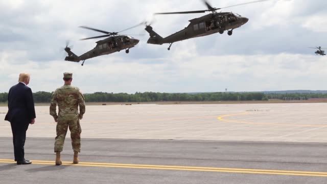 Donald J Trump receives an air assault and gun raid demonstration and howitzer slingload operation by 10th Combat Aviation Brigade and infantry and...