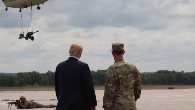 donald j trump receives an air assault and gun raid demonstration and howitzer slingload operation by 10th combat aviation brigade and infantry and... - visit stock videos & royalty-free footage