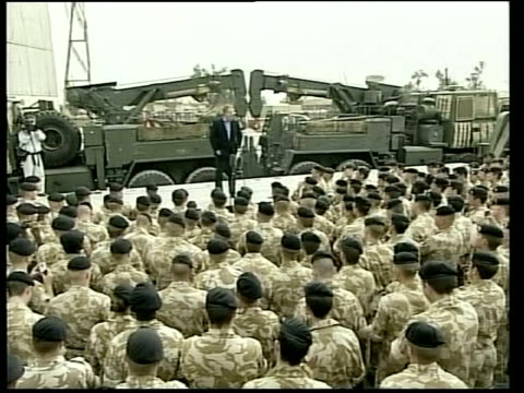 donald rumsfeld visits falluja; lib iraq: basra: ext tony blair speaking to troops on visit to british forces in basra - アルファルージャ点の映像素材/bロール