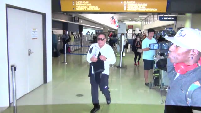 donald sterling new girlfriend departing at lax airport in los angeles at celebrity sightings in los angeles on october 27 2015 in los angeles... - girlfriend stock videos & royalty-free footage