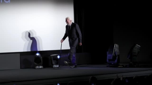 Donald Sutherland jokes around as he receives the Lifetime Achievement Award from Zurich Film Festival director Karl Spoerri at the 'Ella John'...