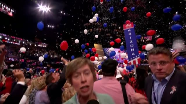 donald trump accepts nomination at republican national convention balloons dropping onto delegates tilt down reporter to camera sot - republican national convention stock videos & royalty-free footage