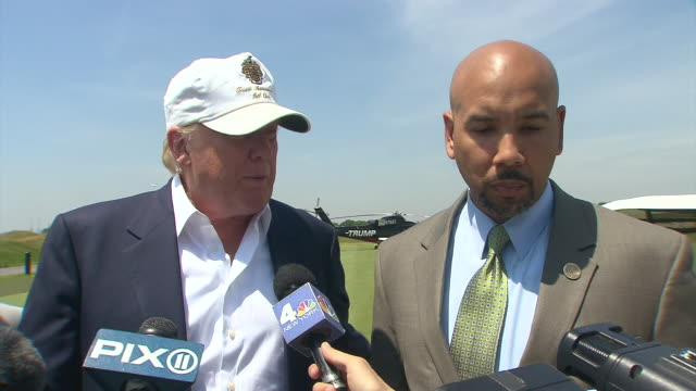 donald trump addresses the media and explains that his new golf course will bring many jobs to the people of the bronx trump ferry point golf course... - golf links stock videos & royalty-free footage