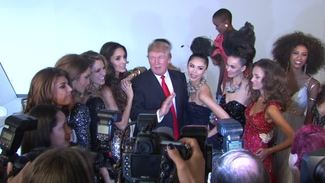 donald trump and former miss universe beauty queens at the donald trump poses with former miss universe beauty queens for iconic photoshoot with... - former stock videos & royalty-free footage