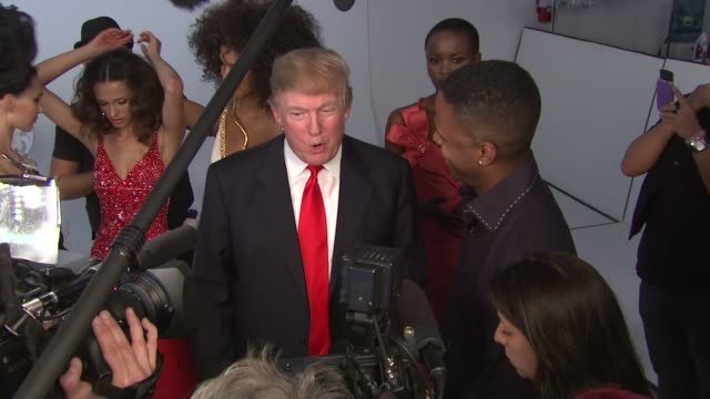 stockvideo's en b-roll-footage met donald trump and former miss universe beauty queens at the donald trump poses with former miss universe beauty queens for iconic photoshoot with... - former