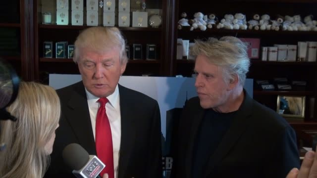 donald trump and gary busey at trump tower in new york, ny, on 4/30/13. - ゲーリー ビジー点の映像素材/bロール