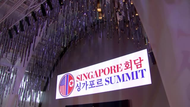 Donald Trump and Kim Jongun arrive in Singapore ahead of summit SINGAPORE INT Various shots 'Singapore Summit' sign over stage Mike Pompeo at podium...