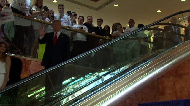 donald trump and melania trump come down escalator at trump tower in new york city. donald trump is about to announce his candidacy for the president... - escalator stock videos & royalty-free footage