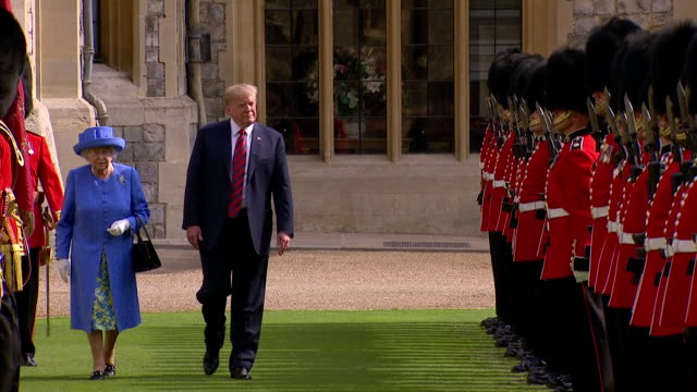 donald trump and queen elizabeth ii inspect the queen's guards at windsor castle during his first official visit to the uk - president trump stock videos and b-roll footage