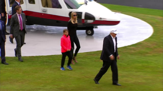 donald trump arrives at golf course in scotland by helicopter with daughter ivanka and son eric. - (war or terrorism or election or government or illness or news event or speech or politics or politician or conflict or military or extreme weather or business or economy) and not usa stock videos & royalty-free footage