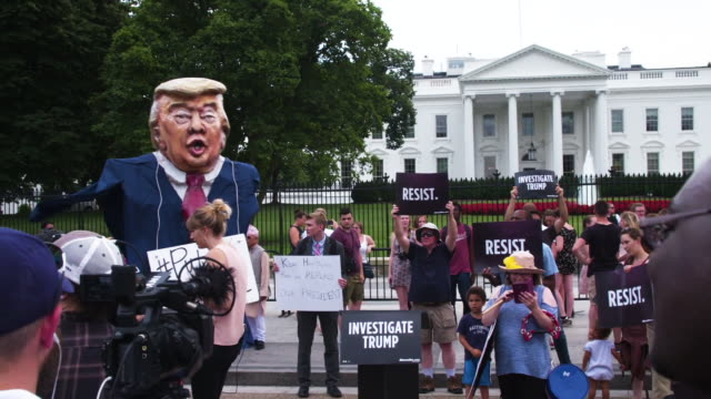 donald trump as putin's puppet with protesters at white house - papier stock videos & royalty-free footage