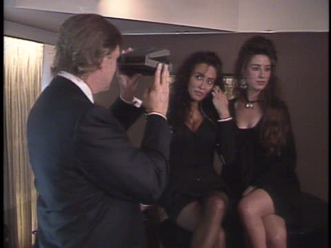 donald trump at photo shoot with playboy models in new york talks about federal lawsuit he filed - photo shoot stock videos & royalty-free footage