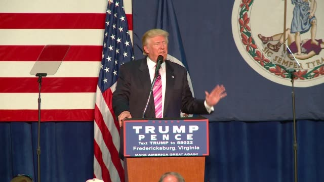donald trump campaign speech in fredericksburg, virginia. includes soundbites on refugees and ends on a series of slogans & phrases about making... - https stock videos & royalty-free footage