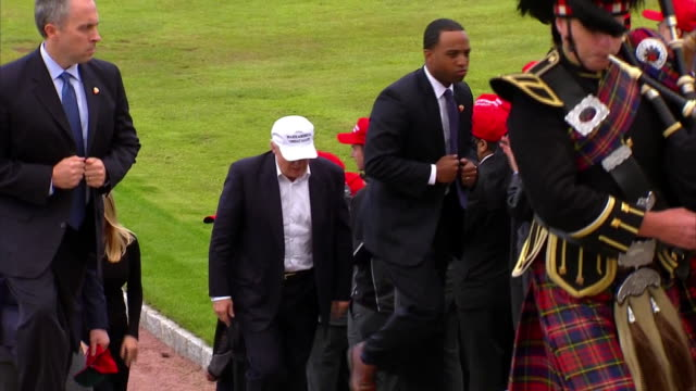 donald trump greets supporters at his golf course in turnberry, scotland with daughter ivanka and son eric. - healthcare and medicine or illness or food and drink or fitness or exercise or wellbeing stock videos & royalty-free footage