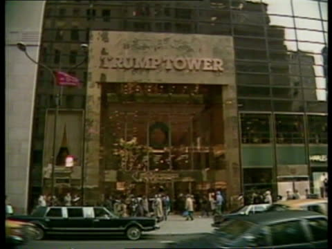 donald trump keeps creditors at bay; usa: new york: int gvs 'trump' board game being played ext gv trump tower - ブランド名点の映像素材/bロール