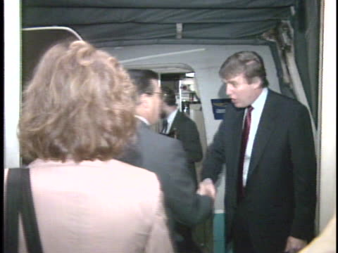 stockvideo's en b-roll-footage met donald trump launches his new trump shuttle service today that offers flights between ny and washington / trump shakes hands with passengers / trump... - cabine