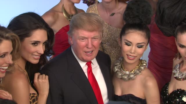 stockvideo's en b-roll-footage met donald trump poses with former miss universe beauty queens for iconic photoshoot with fadil berisha new york ny united states - former