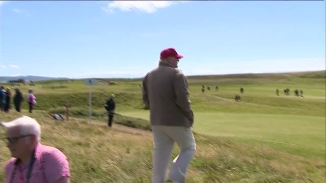Donald Trump press conference Trump giving thumbs up and saying 'fellas go watch golf' SOT / Trump walking along and looking at golf course / Trump...