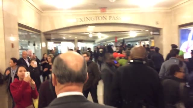 donald trump protest videos include the symbolic hanging of a donald trump piñata, protesters storming the terminal at grand central station, and... - papier stock videos & royalty-free footage