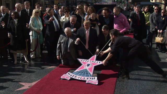 donald trump receives star on the hollywood walk of fame / trump's star ceremony is presented by the honorary mayor of hollywood johnny grant this... - ウォークオブフェーム点の映像素材/bロール