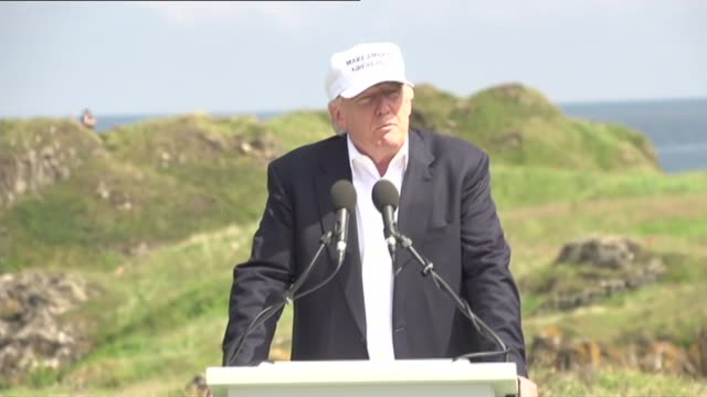 aberdeenshire turnberry ext donald trump along to podium / lee nelson along to protest with swastika golf balls donald trump speech sot major vote... - nazi swastika stock videos and b-roll footage