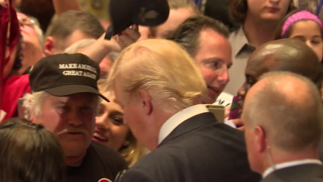 donald trump signs autographs of supporters after rally in hilton head south carolina. he wears a red tie and an american flag pin as he stands at... - elezione video stock e b–roll