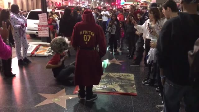 donald trump star covered for protection and conflicting hotspot now the heart of hollywood, the hollywood and highland center on the walk of fame... - hollywood and highland center stock videos & royalty-free footage