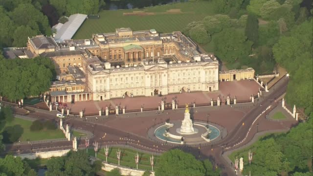 day one air views of buckingham palace winfield house and us aircraft in flight england london buckingham palace and the mall lined with union jack... - state visit stock videos & royalty-free footage
