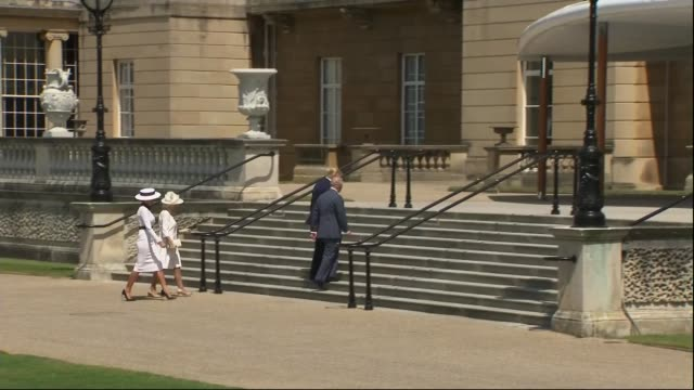 day one trump family arrives in london / visits buckingham palace england london buckingham palace ext prince charles prince of wales and camilla... - principe carlo principe del galles video stock e b–roll